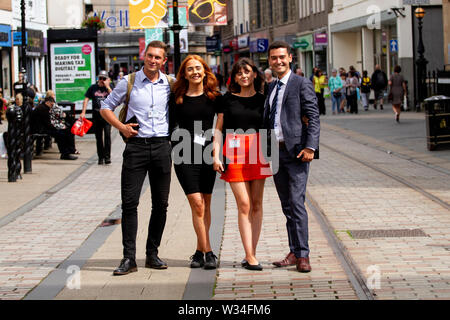 Dundee, Tayside, Scotland, UK. 12th July, 2019. UK weather: Energy comparison canvassers stop to have their photograph taken in Dundee, UK - Stock Photo
