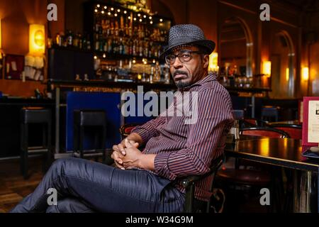 EXCLUSIVE - 09.07.2019, US-American guitarist, singer, composer and record producer Vasti Jackson at an exclusive photo shoot at Café Rix in Berlin-Neukolln. The blues guitarist was nominated for the coveted music award at the 59th Grammy Awards for The Soul of Jimmie Rodgers in 2017 in the Best Traditional Blues Album category. On June 11, 2019 Vasti Jackson was honored by the Swedish Konig with the Polar Music Prize. Currently, Vasti Jackson is on the stage as Ike Turner in the show 'Simply the Best - The Tina Turner Story' at the Estrel Hotel in Berlin. | usage worldwide - Stock Photo