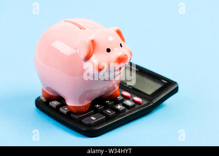 moneybox with calculator. Piggy bank. bookkeeping. financial problem. planning and counting budget. money saving. Accounting and payroll. income capital management. Successful and wealthy. - Stock Photo