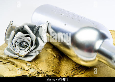 Silver metal. Romantic date. Birthday gift. Silver fashion. Alcohol drink. Luxury wine. Metallic silver color. Winery concept. Floral wine. Metal flower in steel silver bottle. Forging and sculpture. - Stock Photo