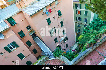 Unusual apartment building with entrance on the fifth floor, Genoa, Italy - Stock Photo