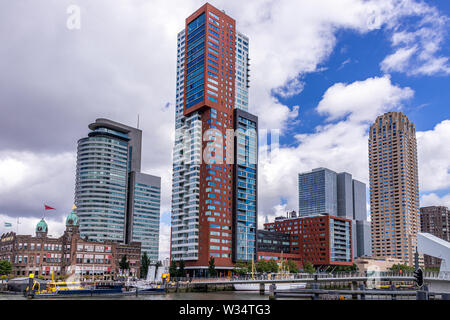 Skyline of Kop van Zuid district in Rotterdam, Netherlands, with Hotel New York and skyscapers World Port Center, Montevideo tower and New Orleans tow