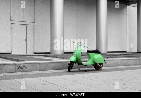 parked scooter in downtown Berlin - Stock Photo