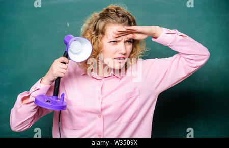 knowledge light. teacher with lamp at school blackboard. student girl working with electricity. brainstorming woman. enlightenment. idea and inspiration. education concept. back to school. - Stock Photo