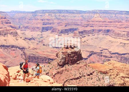 Grand Canyon hiking people. Hiker couple enjoying hike and view on South Kaibab Trail, south rim of Grand Canyon, Arizona, USA. - Stock Photo