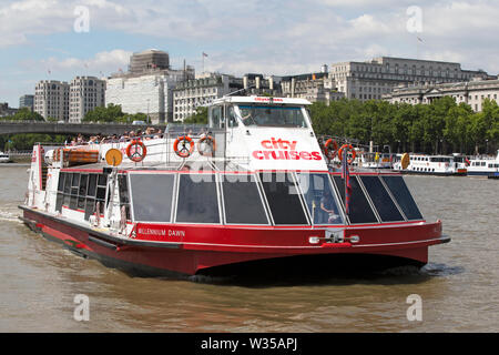 Millennium Dawn one of City Cruises sightseeing boats on the river Thames, London, UK. - Stock Photo