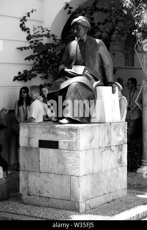 Detail of statue in honor of Moses ben Maimon, or Maimonides, a medieval Sephardic Jewish scholar, in Córdoba, Spain. - Stock Photo