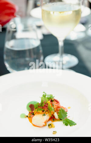 Chili crab cooked in a modern way on restaurant table outdoors - Stock Photo