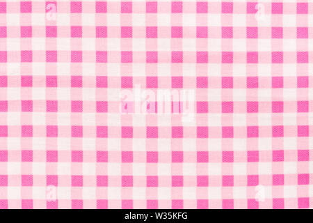 Pink and white checkered fabric background. High quality texture in extremely high resolution. - Stock Photo