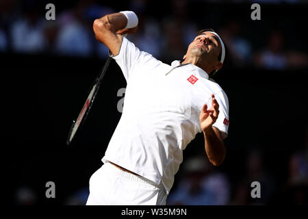 London, UK. 12th July, 2019. The All England Lawn Tennis and Croquet Club, Wimbledon, England, Wimbledon Tennis Tournament, Day 11;  Roger Federer (SUI) serves to Rafael Nadal (ESP) Credit: Action Plus Sports Images/Alamy Live News - Stock Photo