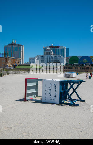 Atlantic City, New Jersey - May 24, 2019: A lifeguard stand was seen on its side on the sand on a deserted Atlantic City Beach. Resorts and Hard Rock - Stock Photo