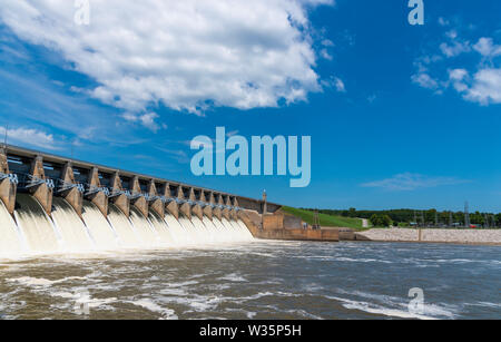 Water flowing through the open gates of a hydro electric power station - Stock Photo