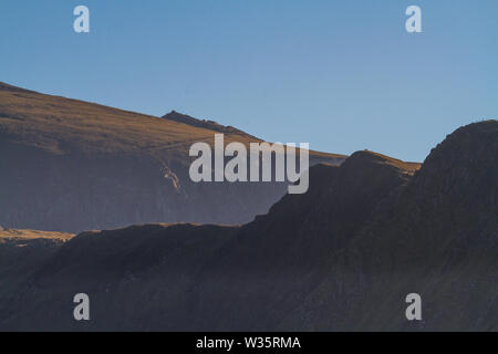 The peak of Snowdon above other hills taken from Llanberis, Snowdonia, North Wales. - Stock Photo