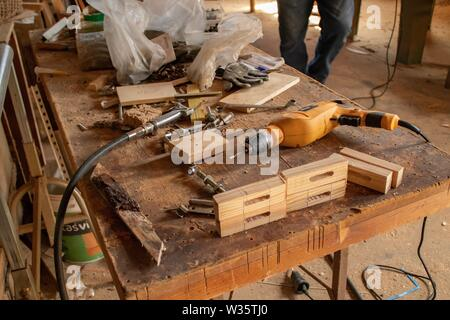 Old woodworking machinery on natural light. Traditional art. - Stock Photo