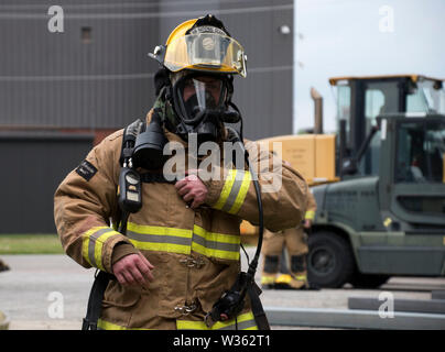 Firefighters from the 179th Airlift Wing gear up and test firefighting equipment during a readiness exercise May 18, 2019, at the 179th Airlift Wing, Mansfield, Ohio. The firefighters train often on running drills and testing equipment in order to stay prepared for the mission ahead. (U.S. Air National Guard photo by Senior Airman Christi A. Richter) - Stock Photo
