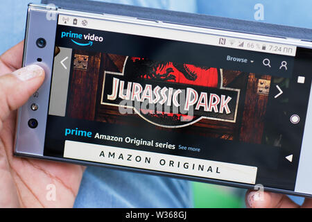Amazon Prime Video, Prime Amazon Original Series, Jurassic Park Movie streaming website on Smartphone Mobile Phone screen - Stock Photo