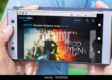 Amazon Prime Video, Prime Amazon Original Series, Good Omens Movies streaming website on Mobile Phone screen - Stock Photo