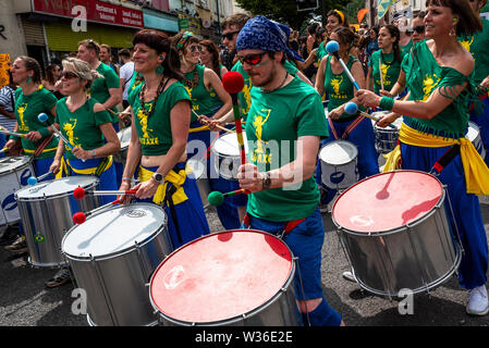 St Pauls, Bristol, UK. July 6th 2019. The 51st St Pauls Carnival Procession wound its way through Bristols St Pauls on a hot and sunny Saturday afternoon. The carnival attracted around 100,000 people. Organised by the St Pauls Carnival Community Interest Company. Pictured, many of the Samba bands in the procession. Credit: Stephen Bell/Alamy - Stock Photo