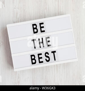 Lightbox with 'Be the best' words on a white wooden background. Flat lay, overhead, top view, from above. - Stock Photo