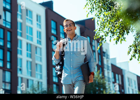 Businessman leaving residential area while walking to the office - Stock Photo