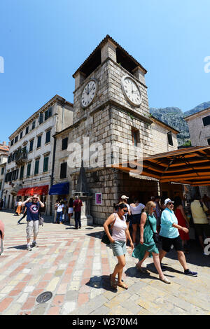 The clock tower at the Square of Arms in the old town of Kotor, Montenegro. - Stock Photo