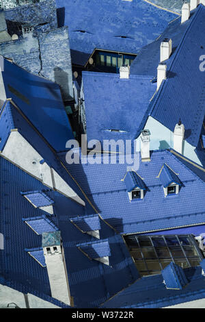 Aerial view over blue roof tiles in Sibiu city, Romania - Stock Photo
