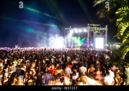 Malaga, Spain - June 24, 2018. Young people celebrate the Night of San Juan with music and dance on the Malagueta beach, Malaga city, Spain - Stock Photo