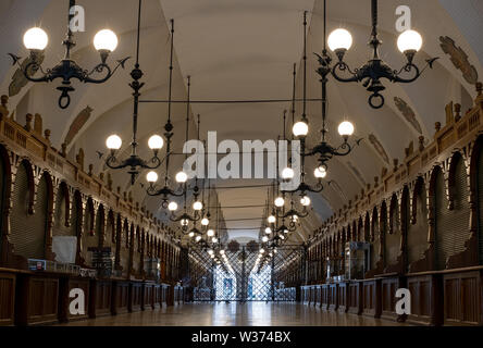 The Cloth Hall building in the Main Square in Krakow old town, Poland, photographed in early morning before it opens. - Stock Photo