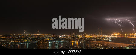 Lightning storm over city. - Stock Photo