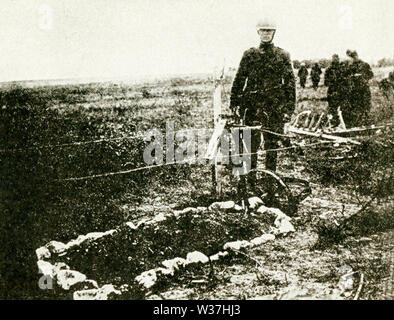 This photo, dating to before 1922, relates to World War I. The caption reads: The grave of Lieut. Quentin Roosevelt, aviator and son of ex-President Roosevelt, who was killed during an air raid over enemy lines on July 14, 1918, has been located in France. - Stock Photo
