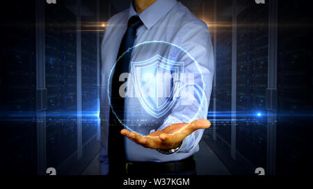 Man with dynamic cyber security with shield symbol hologram on hand. Businessman showing futuristic concept of digital protection, firewall and comput - Stock Photo