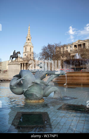 Admiral Jellicoe Memorial Fountain Trafalgar Square with bronze statue of King George IV on  horse and St Martin-in-the-Fields church London - Stock Photo