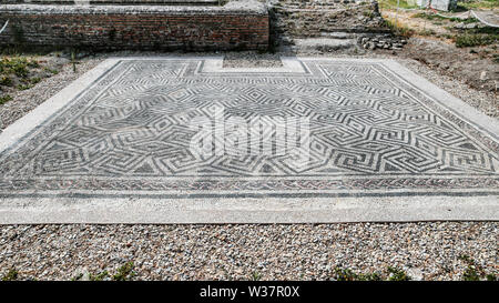 Roman mosaic pavement located in Piazza della Vittoria - Victory square - in the archaeological excavation of Ostia Antica - Rome - Stock Photo