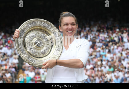 London, UK. 13th July, 2019. Simona Halep (ROU) with the trophy after winning her match against Serena Williams (USA) in their Ladies' Singles Final match. Credit: Andrew Patron/ZUMA Wire/Alamy Live News - Stock Photo