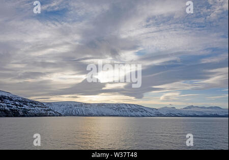 Sun and Clouds in the High Arctic on Baffin Island in Nunavut, Canada - Stock Photo