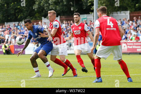 Richmond Park, Dublin, Ireland. 13th July, 2019. Pre season football friendly, St Patricks versus Chelsea; Kenedy of Chelsea FC challenges for the ball Credit: Action Plus Sports/Alamy Live News - Stock Photo