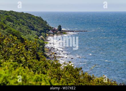 Helligpeder, Denmark. 09th July, 2019. The west coast of the Danish Baltic Sea island near the small fishing village Helligpeder. The island Bornholm is, together with the offshore archipelago Ertholmene, Denmark's most eastern island. Thanks to its location, the island of Bornholm counts many hours of sunshine. Credit: Patrick Pleul/dpa-Zentralbild/ZB/dpa/Alamy Live News - Stock Photo