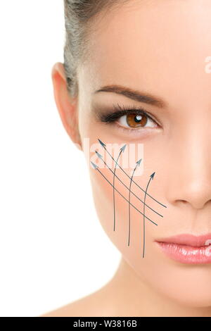 Face lift anti-aging treatment - Asian woman portrait with graphic lines showing facial lifting effect on perfect skin. Skincare cosmetic concept. - Stock Photo