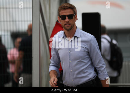Silverstone Circuit. Northampton, UK. 13th July, 2019. FIA Formula 1 Grand Prix of Britain, Qualification Day; Pundit Jenson Button arrives for qualifying Credit: Action Plus Sports/Alamy Live News - Stock Photo