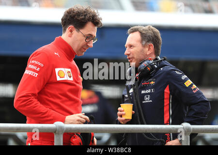 Silverstone Circuit. Northampton, UK. 13th July, 2019. FIA Formula 1 Grand Prix of Britain, Qualification Day; Christian Horner chats with Mattia Binotto Credit: Action Plus Sports/Alamy Live News - Stock Photo