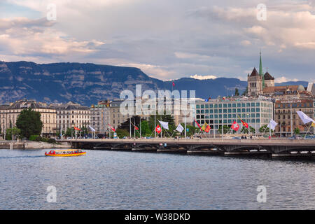Shuttle boat on Lake Geneva. St.Peter cathedral and Mont Saleve in the background. - Stock Photo