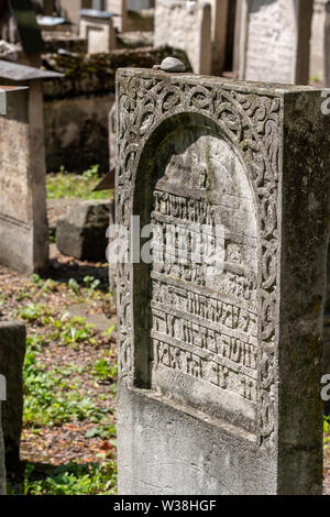 Gravestones at the small disused Remuh / Remah Cemetery on Szeroka Street in Kazimierz, the historic Jewish quarter of Krakow, Poland - Stock Photo