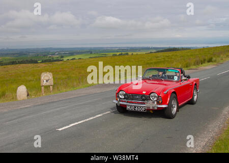 1968 Triumph TR5 at Scorton, Lancashire. UK Weather 13th July, 2019. Sunny conditions as the Lancashire Car Club Rally Coast to Coast crosses the Trough of Bowland. 74 vintage, classic, collectible, heritage, historics vehicles left Morecambe heading for a cross county journey over the Lancashire landscape to Whitby. A 170 mile trek over undulating landscape as part of the classics on tour car club annual event. Credit: MediaWorldImages/Alamy Live News - Stock Photo