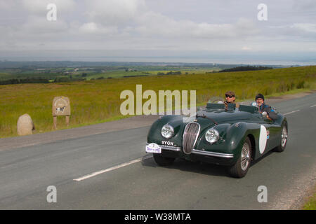1951 Jaguar XK120 at Scorton, Lancashire. UK Weather 13th July, 2019. Sunny conditions as the Lancashire Car Club Rally Coast to Coast crosses the Trough of Bowland. 74 vintage, classic, collectible, heritage, historics vehicles left Morecambe heading for a cross county journey over the Lancashire landscape to Whitby. A 170 mile trek over undulating landscape as part of the classics on tour car club annual event. Credit: MediaWorldImages/Alamy Live News - Stock Photo