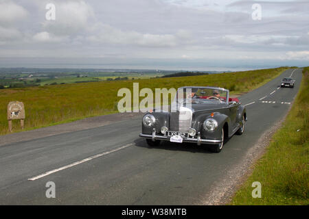 1953 Mercedes 300S at Scorton, Lancashire. UK Weather 13th July, 2019. Sunny conditions as the Lancashire Car Club Rally Coast to Coast crosses the Trough of Bowland. 74 vintage, classic, collectible, heritage, historics vehicles left Morecambe heading for a cross county journey over the Lancashire landscape to Whitby. A 170 mile trek over undulating landscape as part of the classics on tour car club annual event. Credit: MediaWorldImages/Alamy Live News - Stock Photo