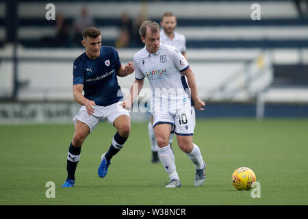 Starks Park, Kirkcaldy, UK. 13th July, 2019. Scottish League Cup football, Raith Rovers versus Dundee; Paul McGowan of Dundee and Ross Matthews of Raith Rovers Credit: Action Plus Sports/Alamy Live News - Stock Photo