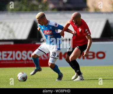 Stadium Carciato, Dimaro, Italy. 13th July, 2019. Pre-season football freindly, Napoli versus Benevento; Gianluca Gaetano of Napoli challenged by Luca Caldirola of Benevento Credit: Action Plus Sports/Alamy Live News - Stock Photo
