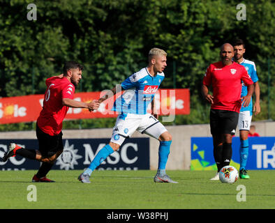 Stadium Carciato, Dimaro, Italy. 13th July, 2019. Pre-season football freindly, Napoli versus Benevento; Gianluca Gaetano of Napoli challenged by Giovanni Volpicelli of Benevento Credit: Action Plus Sports/Alamy Live News - Stock Photo