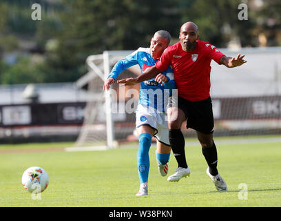 Stadium Carciato, Dimaro, Italy. 13th July, 2019. Pre-season football freindly, Napoli versus Benevento; Samuel Armenteros of Benevento challenged by Jose Callejon of Napoli Credit: Action Plus Sports/Alamy Live News - Stock Photo