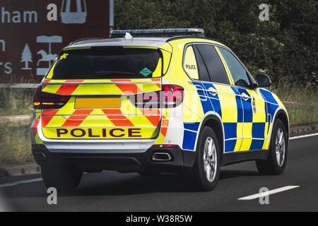 Marked Police 4x4 Responding to emergency speeding down motorway. - Stock Photo